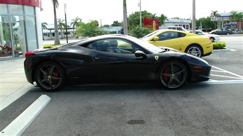 Black Ferrari 458 italia start up and drive out of