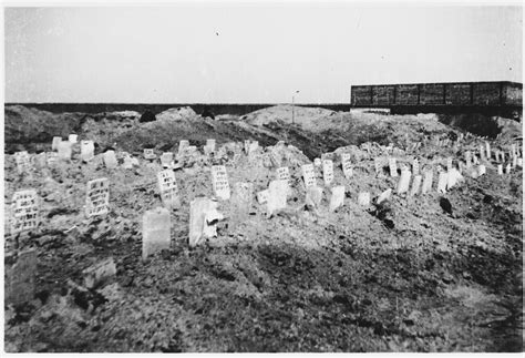 Makeshift tombstones mark the mass grave of Jewish victims