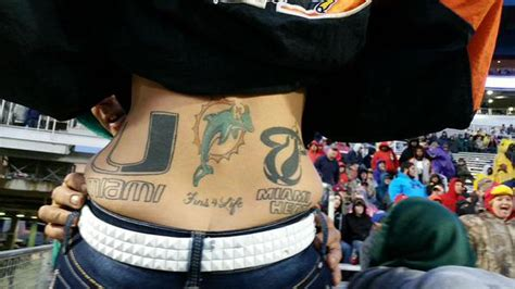 Miami sports fan shows off her 'Champ Stamp' tattoo