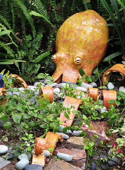 Outdoor ceramic octopus sculpture with tentacles that