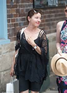 Tina Arena steps out with a friend after THAT very